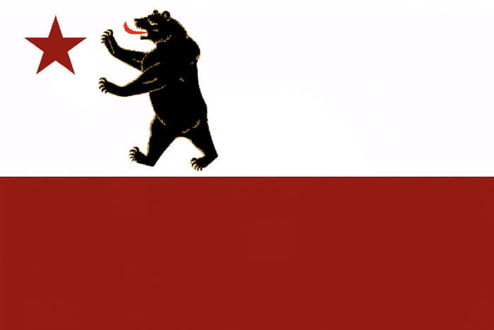 a horizontal bicolor of white and red, the white upper half charged with a red star and a bear on its hind legs