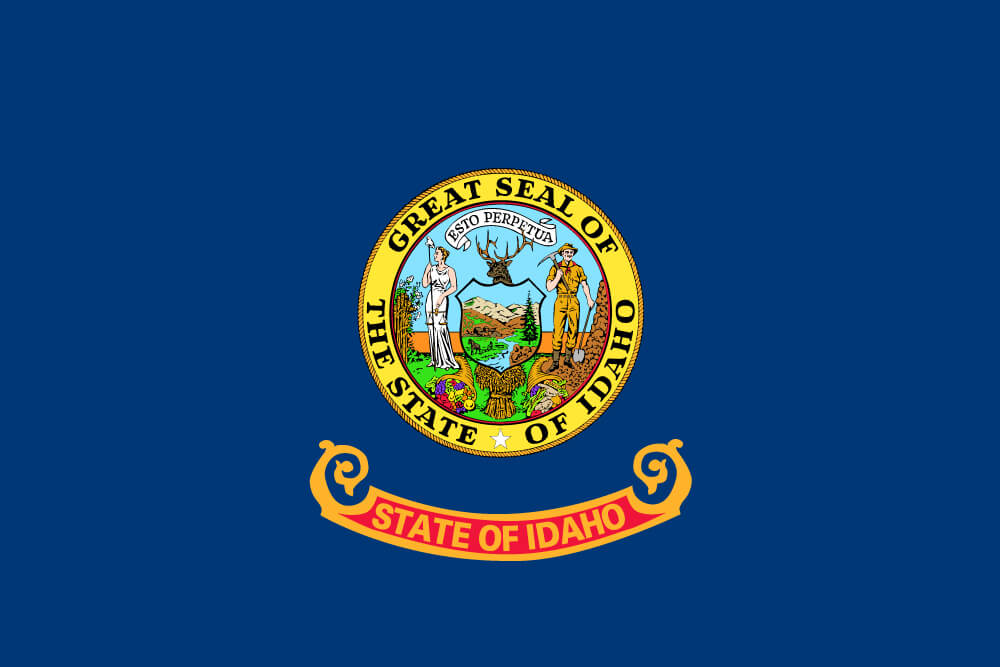 "a field of blue charged with the state seal featuring the goddess Justice and a miner; ""Idaho"" is inscribed on a banner below"